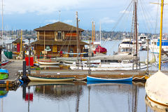 Small sailboats and rowboats near the Wooden Boats museum. SEATTLE, USA – MARCH 22, 2016: Center for Wooden Boats on Lake Union in Seattle on March 22, 2016 Royalty Free Stock Photos