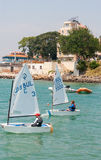 Small sailboats at the shore of Pomorie in Bulgaria Stock Photo
