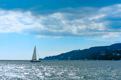 Small sailing boat in blue and calm sea Stock Photo
