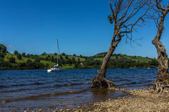 Small sailing boat on Ullswater lake royalty free stock photos