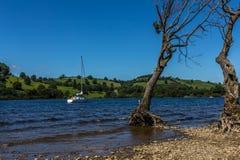 Small sailing boat on Ullswater lake Royalty Free Stock Photos