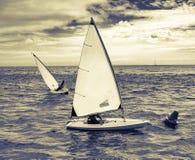 Small sailing boats rounding a buoy off the Dorset coast Stock Photography