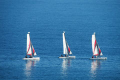 Small sailing boats in the sea Stock Photos