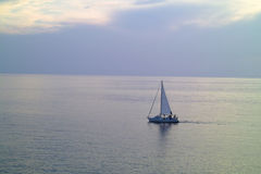 A small sailing yacht in the sea Royalty Free Stock Images