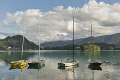 Small sailing yachts moored on Lake Bled, Slovenia. Royalty Free Stock Images