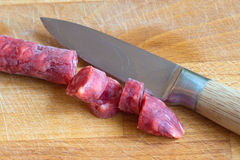 Small salami sliced with a knife Royalty Free Stock Photography