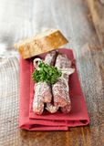 Small salamis on napkin Royalty Free Stock Photos