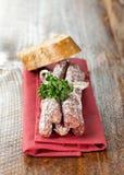 Small salamis on napkin Royalty Free Stock Photos