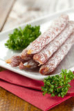 Small salamis with parsley Royalty Free Stock Images