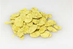 Small sampling of corn flake cereal isolated on white background. Small sampling of corn flake cereal in a pile isolated against a white background Royalty Free Stock Images