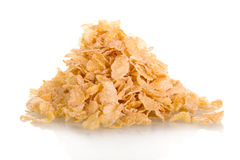 Small sampling of corn flake isolated on white Royalty Free Stock Photography