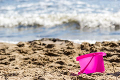 Small sand pail toy on summer beach. Holiday vacation royalty free stock photography