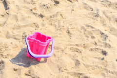 Small sand pail toy on summer beach. Holiday vacation royalty free stock photos
