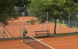 Small sand tennis court. Small tennis court with orange sand Stock Photo