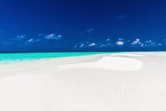 Small sandbar in the middle of tropical lagoon in atoll of Maldi Stock Photo