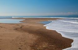 Small sandbar where the Pacific ocean and the Santa Clara river meet at Surfers Knoll beach in Ventura California USA. Small sandbar where the Pacific ocean and royalty free stock photo