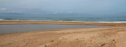 Small sandbar where the Pacific ocean and the Santa Clara river meet at Surfers Knoll beach in Ventura California USA. Small sandbar where the Pacific ocean and royalty free stock photos