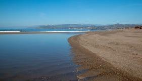 Small sandbar where the Pacific ocean and the Santa Clara river meet at Surfers Knoll beach in Ventura California USA. Small sandbar where the Pacific ocean and stock photography