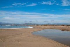 Small sandbar where the Pacific ocean and the Santa Clara river meet at Surfers Knoll beach in Ventura California USA. Small sandbar where the Pacific ocean and royalty free stock photography