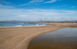 Small sandbar where the Pacific ocean and the Santa Clara river meet at Surfers Knoll beach in Ventura California USA. Small sandbar where the Pacific ocean and stock image