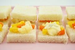 Small sandwich mango apple carrot cucumber bread sliced cream salad Stock Photos