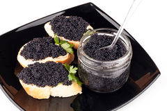 Small sandwiches with black caviar Royalty Free Stock Photography