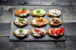 Small sandwiches. Smal sandwiches on dark background Stock Photos