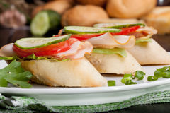 Small sandwiches. Three small sandwiches with ham and vegetables Stock Image