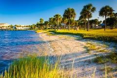 Small sandy beach on the Halifax River in Daytona Beach, Florida Stock Photo