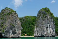 Small sandy beach in the Halong Bay in Vietnam Royalty Free Stock Image