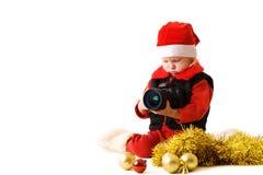 Small Santa with camera Royalty Free Stock Photos