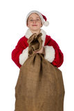 Small Santa Claus with gifts sack. On white background Stock Images