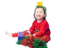 Small Santa Claus girl Royalty Free Stock Images