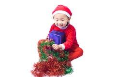 Small Santa Claus girl Stock Photo