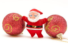Small Santa Claus standing between Christmas toys Royalty Free Stock Photos