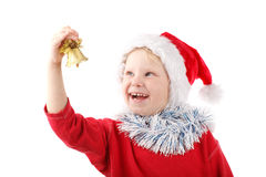 Small Santa ringing a bell Stock Photo