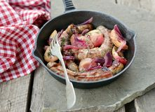 Small sausage with red onion Royalty Free Stock Photo