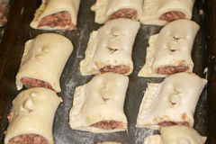 Small sausage rolls prepared and frozen. Royalty Free Stock Photos