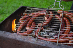 Small sausages on barbecue Royalty Free Stock Photo