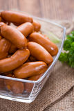 Small Sausages on wood Royalty Free Stock Photography