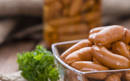 Small Sausages on wood Stock Images