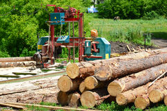 Small sawmill in open air, Russia. Small sawmill in the open air, Russia Royalty Free Stock Photo