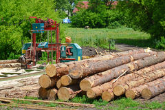 Small sawmill in open air, Russia. Small sawmill in the open air, Russia Stock Photo