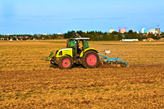 Small scale farming with tractor Royalty Free Stock Image