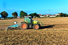 Small scale farming with tractor and plow Stock Photography