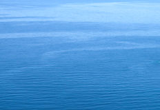 Small scaled blue water background texture Royalty Free Stock Photography