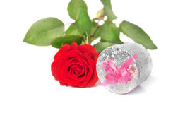 Small scarlet rose and gift Stock Image