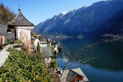 Small scenic village with snowy mountain on the background. Hallstatt waterfront with a great view of snowy mountain on the back Stock Images