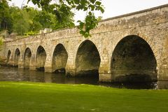 Ten Arch Stone Bridge. Inistioge. county Kilkenny. Ireland. Small scenic village, Ten Arch Stone Bridge over the river Nore. Inistioge. county Kilkenny. Ireland stock photo