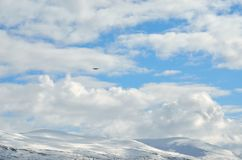 Small school airplane climbing on blue sky Stock Images